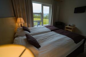 A bed or beds in a room at Hotel Hallormsstadur