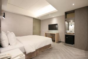 Dandy Hotel-Daan Park Branchにあるベッド