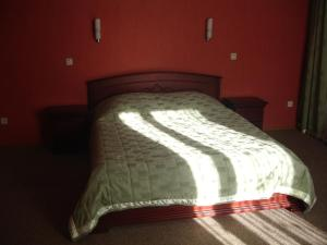 Кровать или кровати в номере Guest House Danaya