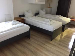 A bed or beds in a room at GZ Hostel Bonn