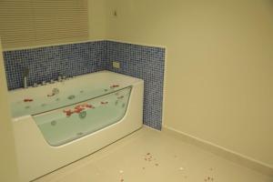 Um banheiro em Amaken Aparthotel