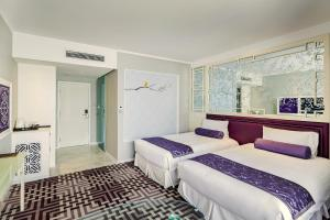 A bed or beds in a room at Dorsett Shanghai