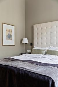 Säng eller sängar i ett rum på Elite Hotel Knaust