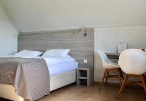 A bed or beds in a room at Vík Cottages