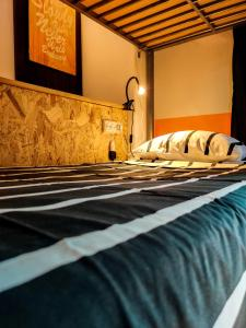 A bed or beds in a room at Sol a Sol Hostel