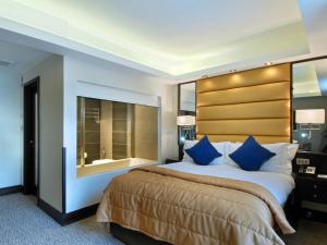A bed or beds in a room at The Marble Arch London