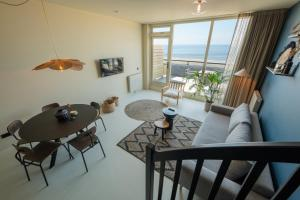 A seating area at Poort Beach Boutique Apartments