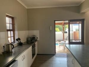 A kitchen or kitchenette at La Gratitude Self catering cottage