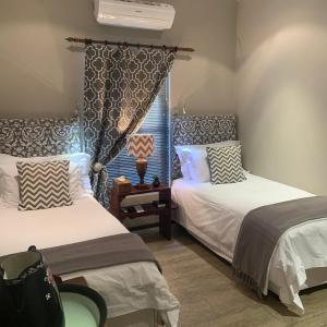 A bed or beds in a room at La Gratitude Self catering cottage