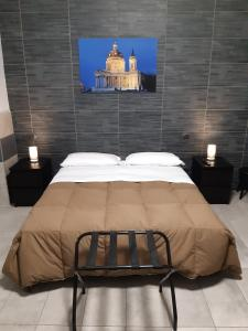 A bed or beds in a room at La Montrucca Camere