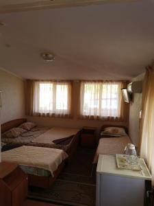 Кровать или кровати в номере Hotel Arkona