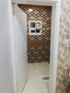 Um banheiro em Al Arjowan Hotel Units