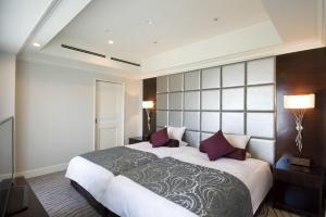 A bed or beds in a room at Kyoto Hotel Okura