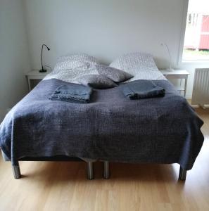 A bed or beds in a room at Djurviks Gästgård