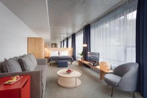 Een zitgedeelte bij Zander K Hotel