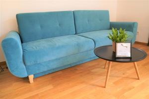 A seating area at Komfortables und ruhiges Airport Apartment in Berlin SXF