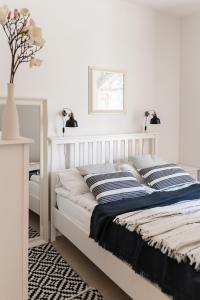 A bed or beds in a room at Apartamenty w Świnoujściu