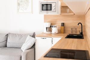 A kitchen or kitchenette at Apartamenty w Świnoujściu