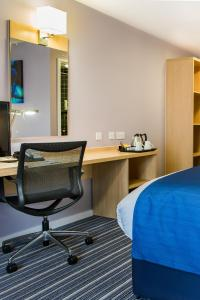 A seating area at Holiday Inn Express Manchester Airport, an IHG Hotel