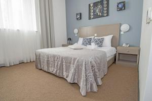 Cama o camas de una habitación en Hotel Amfiteatar