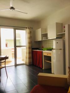 A kitchen or kitchenette at Cala da Lua apartments
