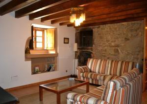 A seating area at O Caseiro de Riba