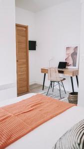 Un ou plusieurs lits dans un hébergement de l'établissement Outsite Coliving Biarritz