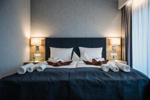 A bed or beds in a room at Hamilton SPA & Wellness