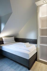 Ein Bett oder Betten in einem Zimmer der Unterkunft Dorint Resort Winterberg Sauerland