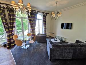 A seating area at The Clarendon Royal Hotel