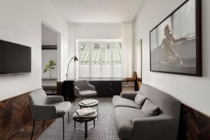 A seating area at Miss Clara by Nobis, Stockholm, a Member of Design Hotels™