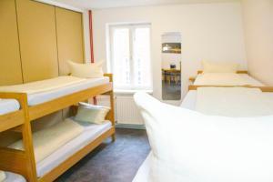 A bunk bed or bunk beds in a room at Altstadt-Hostel CVJM Lübeck