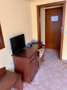 A television and/or entertainment center at Hotel Elena