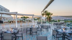 A restaurant or other place to eat at Crowne Plaza Muscat, an IHG Hotel