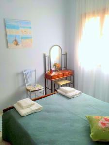 Ένα ή περισσότερα κρεβάτια σε δωμάτιο στο ARITI HOLIDAY APARTMENT