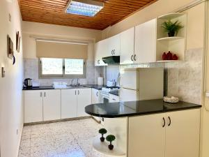 A kitchen or kitchenette at Himonas Apartments