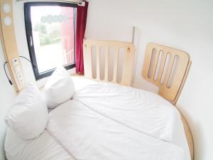 Ein Bett oder Betten in einem Zimmer der Unterkunft slube 25 Teiche Rottstock