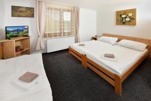 Postel nebo postele na pokoji v ubytování Vila Martina