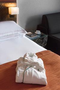 Ένα ή περισσότερα κρεβάτια σε δωμάτιο στο President Hotel