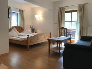Ein Bett oder Betten in einem Zimmer der Unterkunft Hotel Bavaria