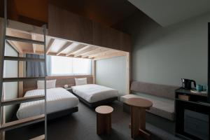 A bunk bed or bunk beds in a room at KAIKA TOKYO by THE SHARE HOTELS