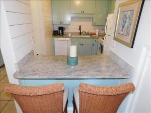 A kitchen or kitchenette at Ocean Walk Resort 2 bdrm Townhome MGR American Dream