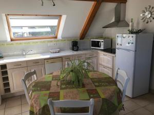 A kitchen or kitchenette at Les Gîtes Du Parun