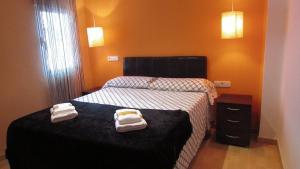 Een bed of bedden in een kamer bij Twenty Granada