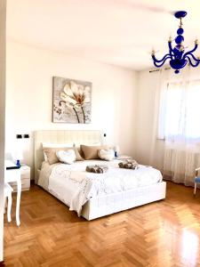 A bed or beds in a room at B&B la Serenissima