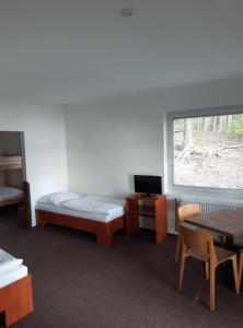 Postel nebo postele na pokoji v ubytování Hotel Na Pláži