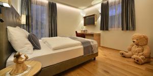 Letto o letti in una camera di Roberta Loft - rooms and apartments
