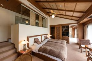 A bed or beds in a room at Nishiizu Crystal View Hotel