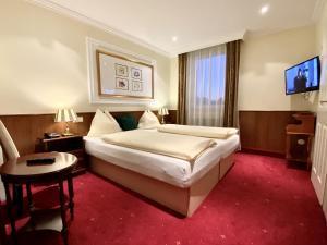 Ein Bett oder Betten in einem Zimmer der Unterkunft Villa Turnerwirt