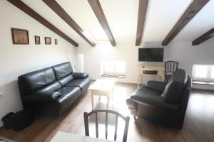 A seating area at Apartments San Rocco